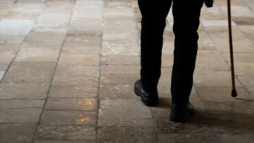 Man in suit walking with a cane   What is Lewy body dementia?